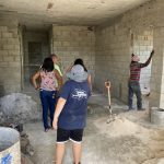 Construction workers building the Hartman Initiative clinic
