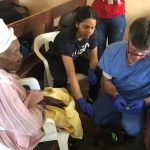 Dr. Todd McCaslin and Daniela working in the Hope for Hispaniola Clinic